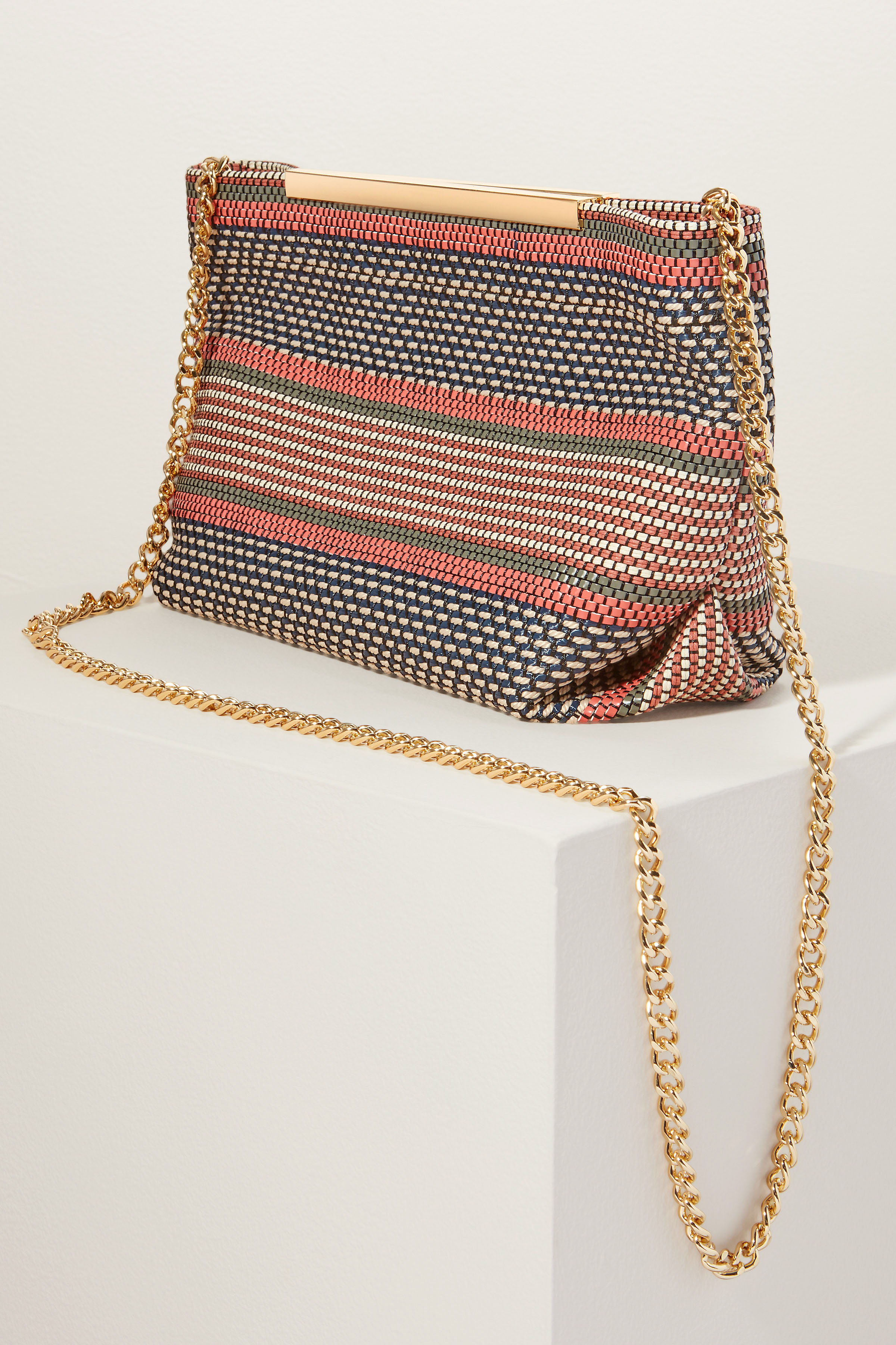 clutch with mixture of raffia, rope, and vegan leather and handwoven detail
